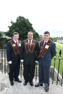 Two new Apprentice Boys from Aghalee with their father after being invested in the Memorial Hall